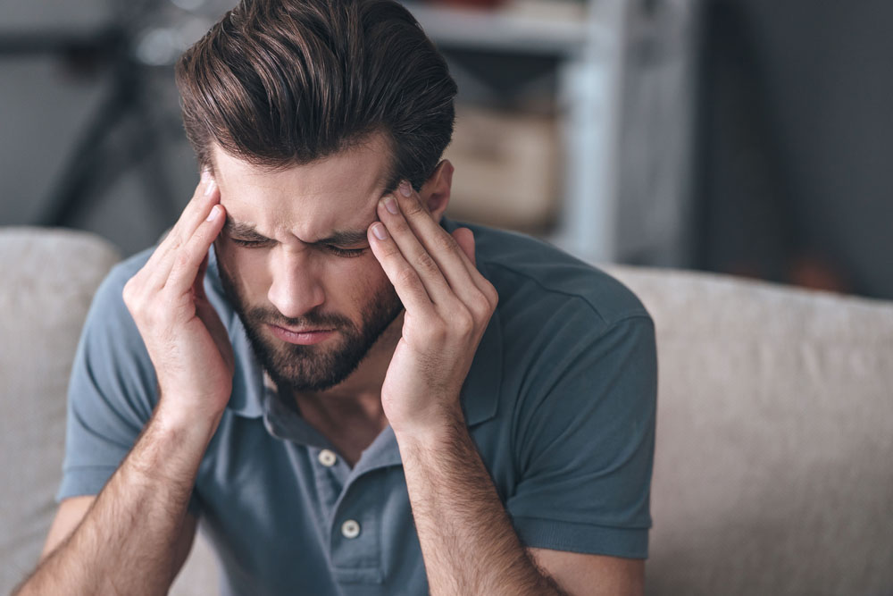 Man suffering from a chronic headache